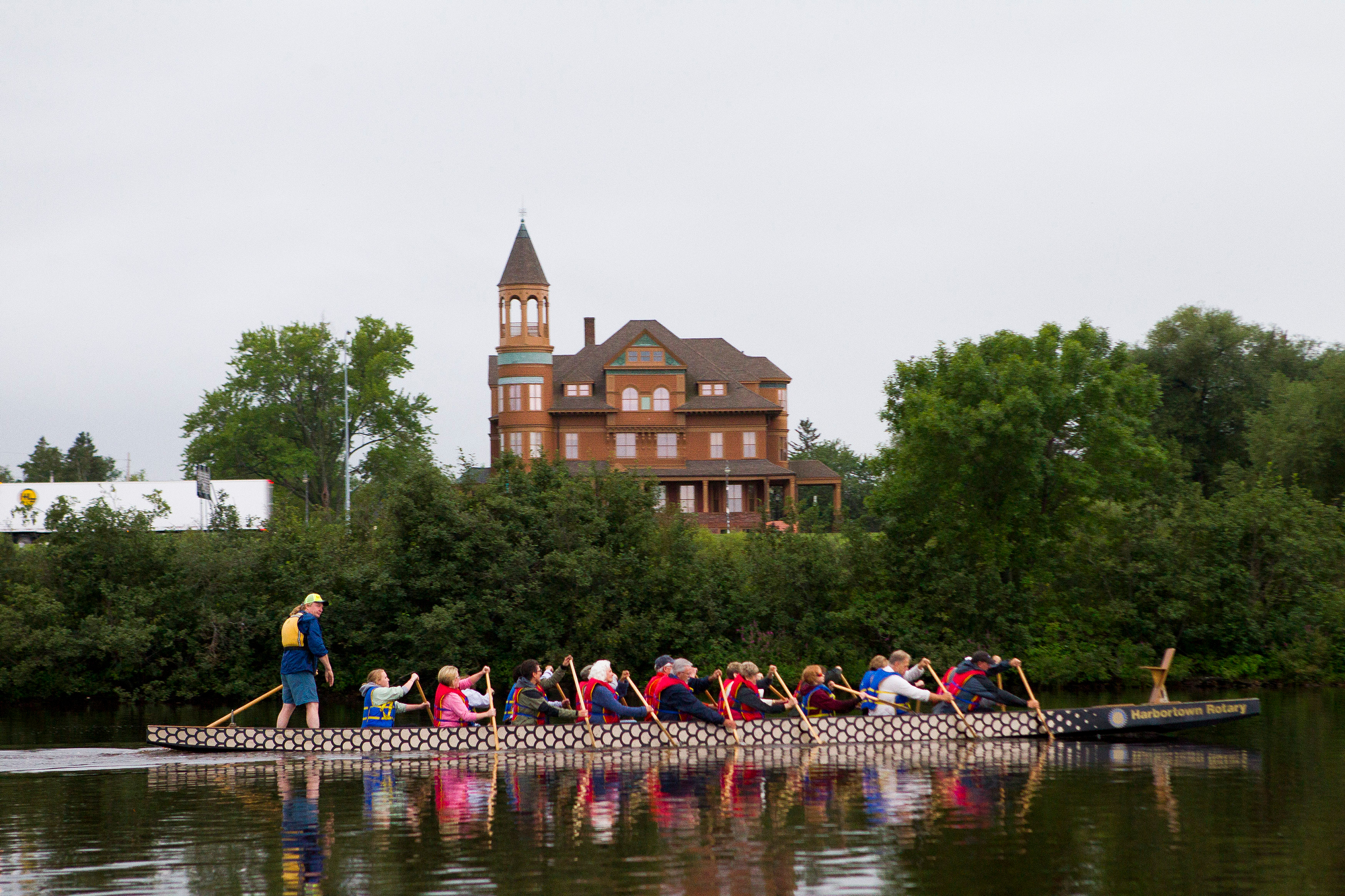 dragon boat paddling in front of Fairlawn Mansion